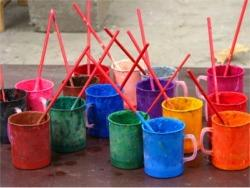 colourful cups brushes